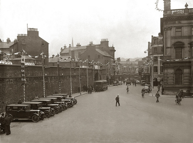 Guildhall Place circa 1932 with old city walls and Northern Counties Hotel just visible behind front building.