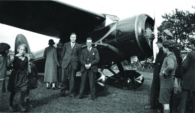 Sightseers surround the Earhart's plane, the Lockheed Vega, shortly after landing in an Irish field just north of Derry City. May 22nd 1932.